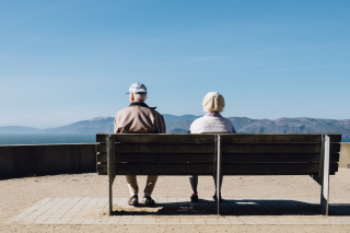 Older couple on park bench looking at mountains Lands End  SF 8-18