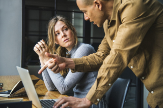 Man giving woman advice 8-18
