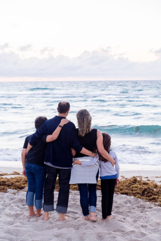 Family of four looking at ocean 9-19