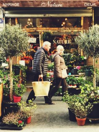 Man and woman walking between nursery plants 4-19