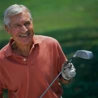 Older man with golf club 3-19