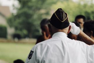 Veteran older saluting 10-19