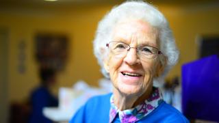 Older woman smiling 8-18