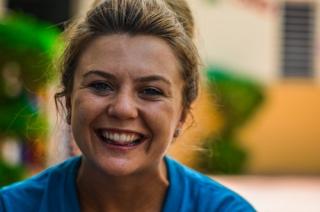 Smiling woman taking selfie 4-19