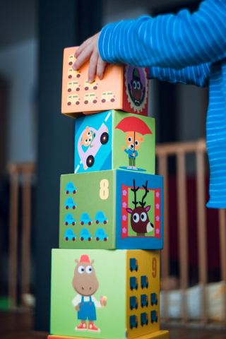 Child stacking play cubes 10-19