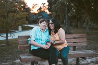Older friends on a park bench 4-19