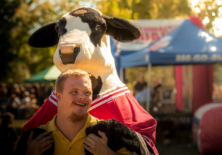 Special Needs Man with Cow Mascot 10-19