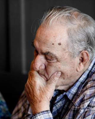 Older man holding chin 9-18