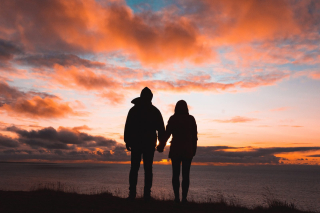 Younger Couple together looking at sunset 8-18