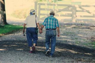 Older Farm couple walking hand in hand 8-18