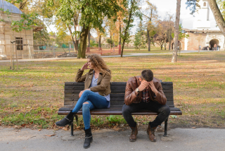 Young couple angry on bench 8-18