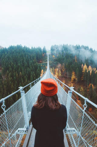 Long walking bridge with girl deciding 2-19