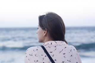 Woman looking out at the sea 8-18